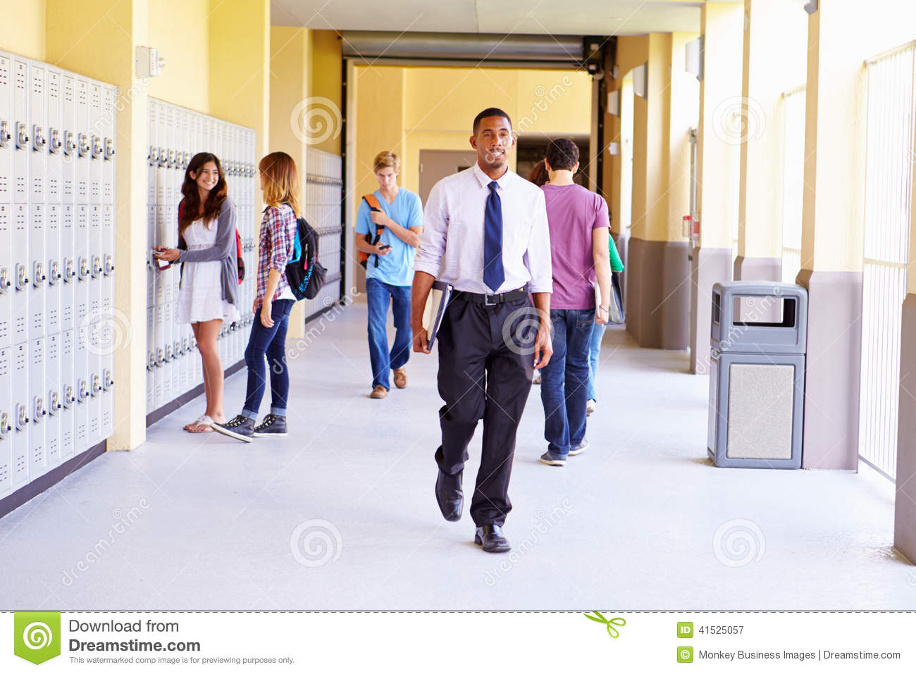 High School Students And Teacher Walking Along Hallway ... Happy High School Student Clipart