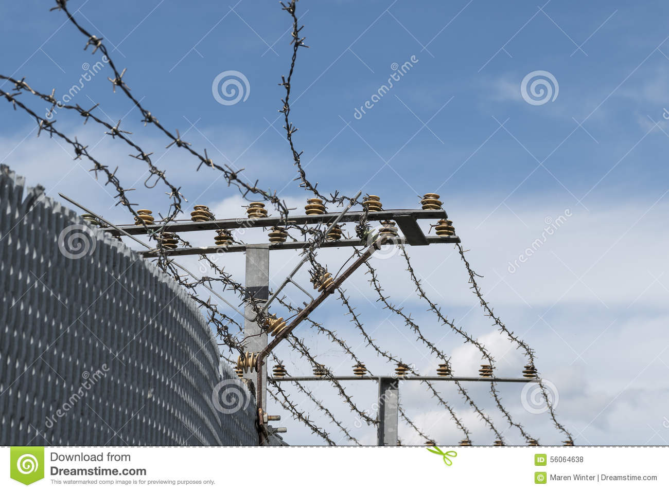 High Security Fence With Electric Barbed Wire Against A