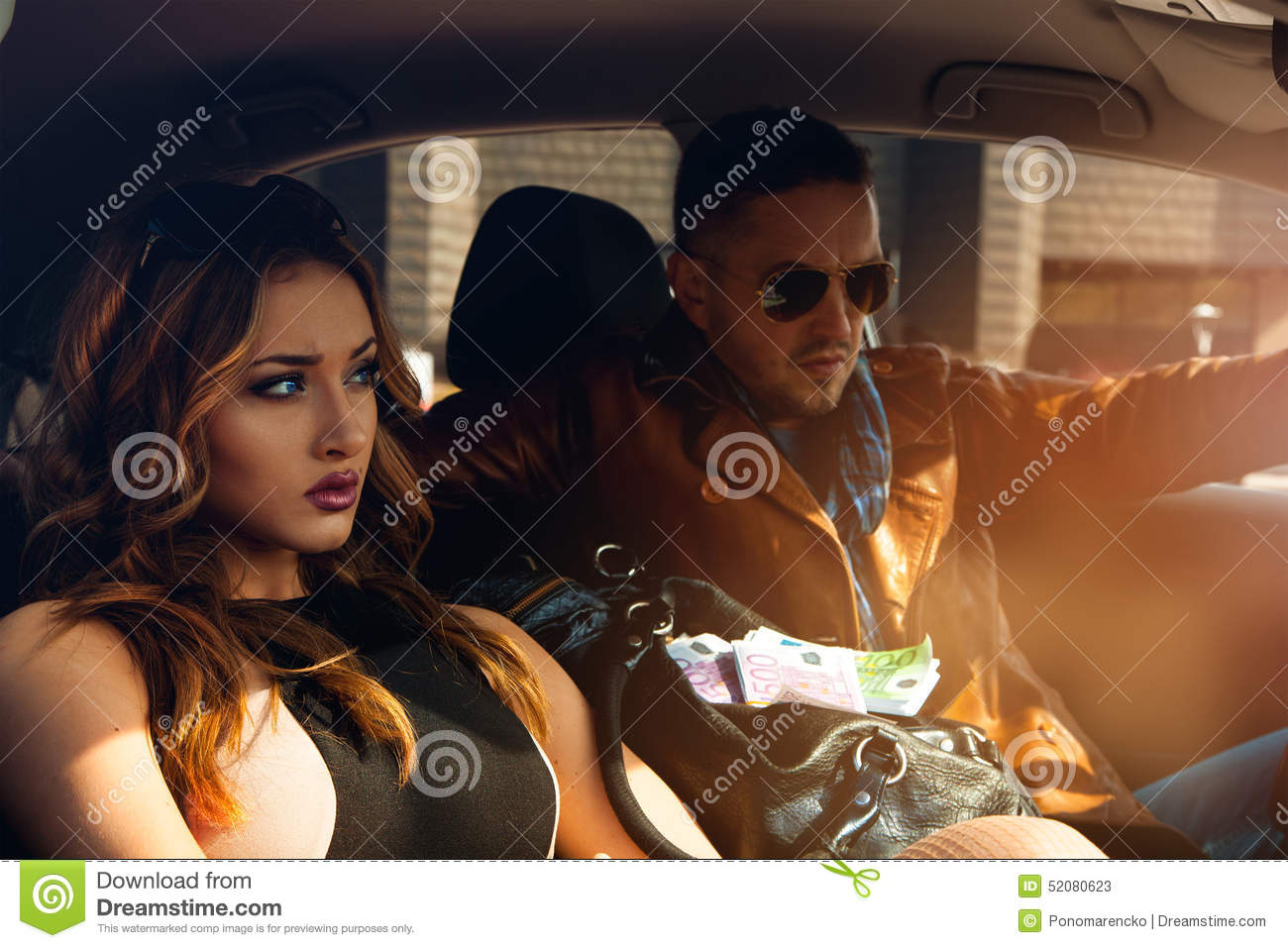 high society couple in car looking away stock image image 52080623. Black Bedroom Furniture Sets. Home Design Ideas