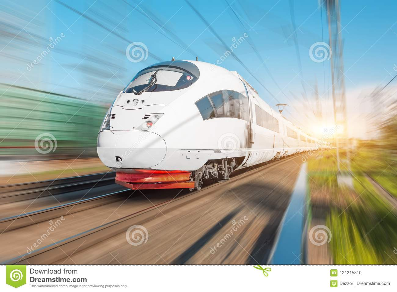 High speed electric train passenger rides at high speed at the railway station in the city.
