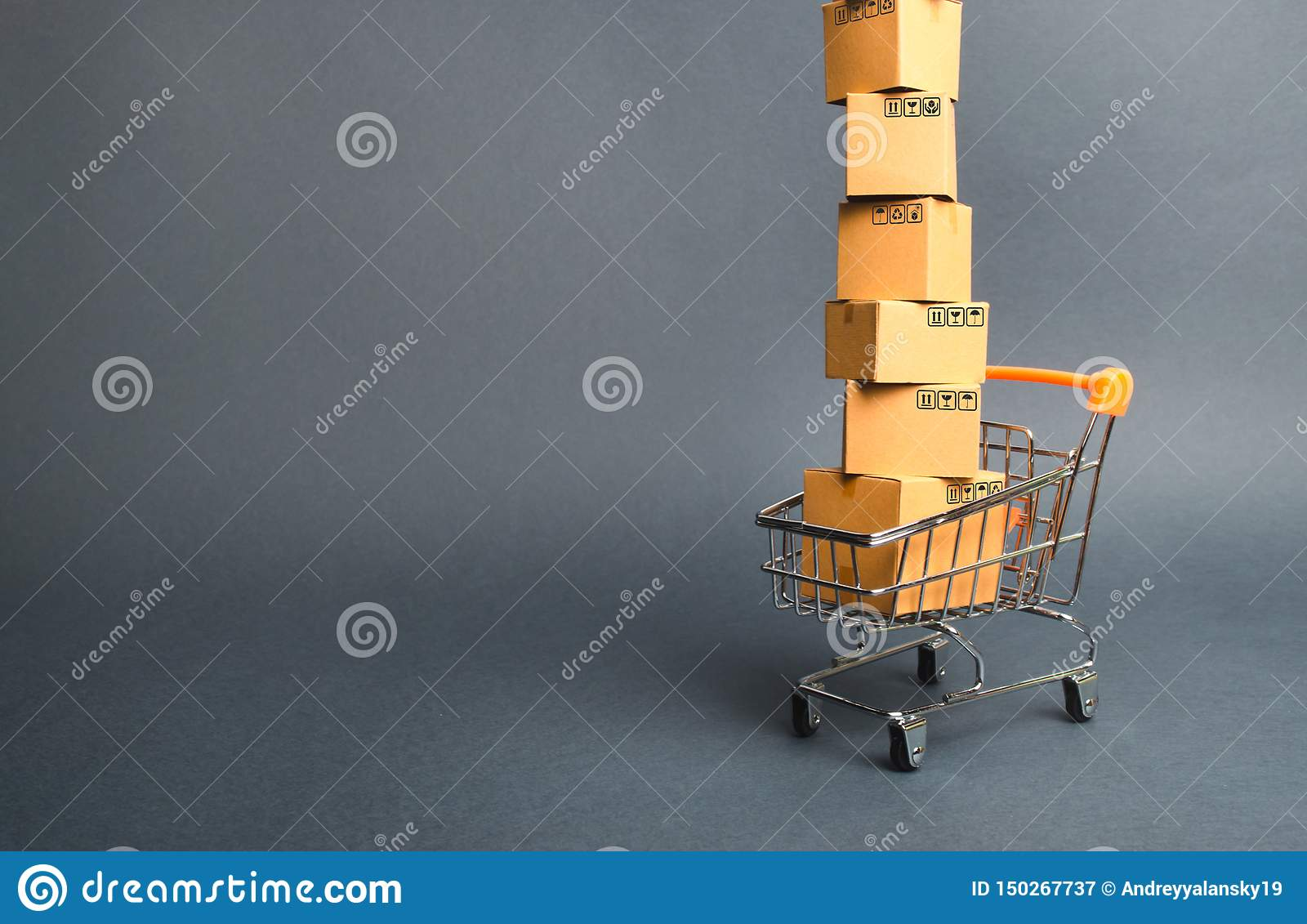 High tower of cardboard boxes on a supermarket trolley. concept of shopping in online store. E-commerce, sales and sale of goods