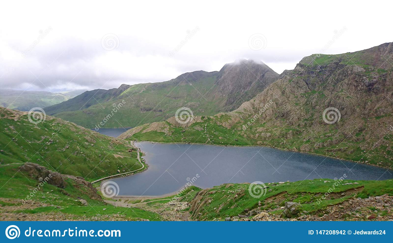 High view looking down over lake on PYG trail on Mount Snowdon in Snowdonia National Park, Wales, UK