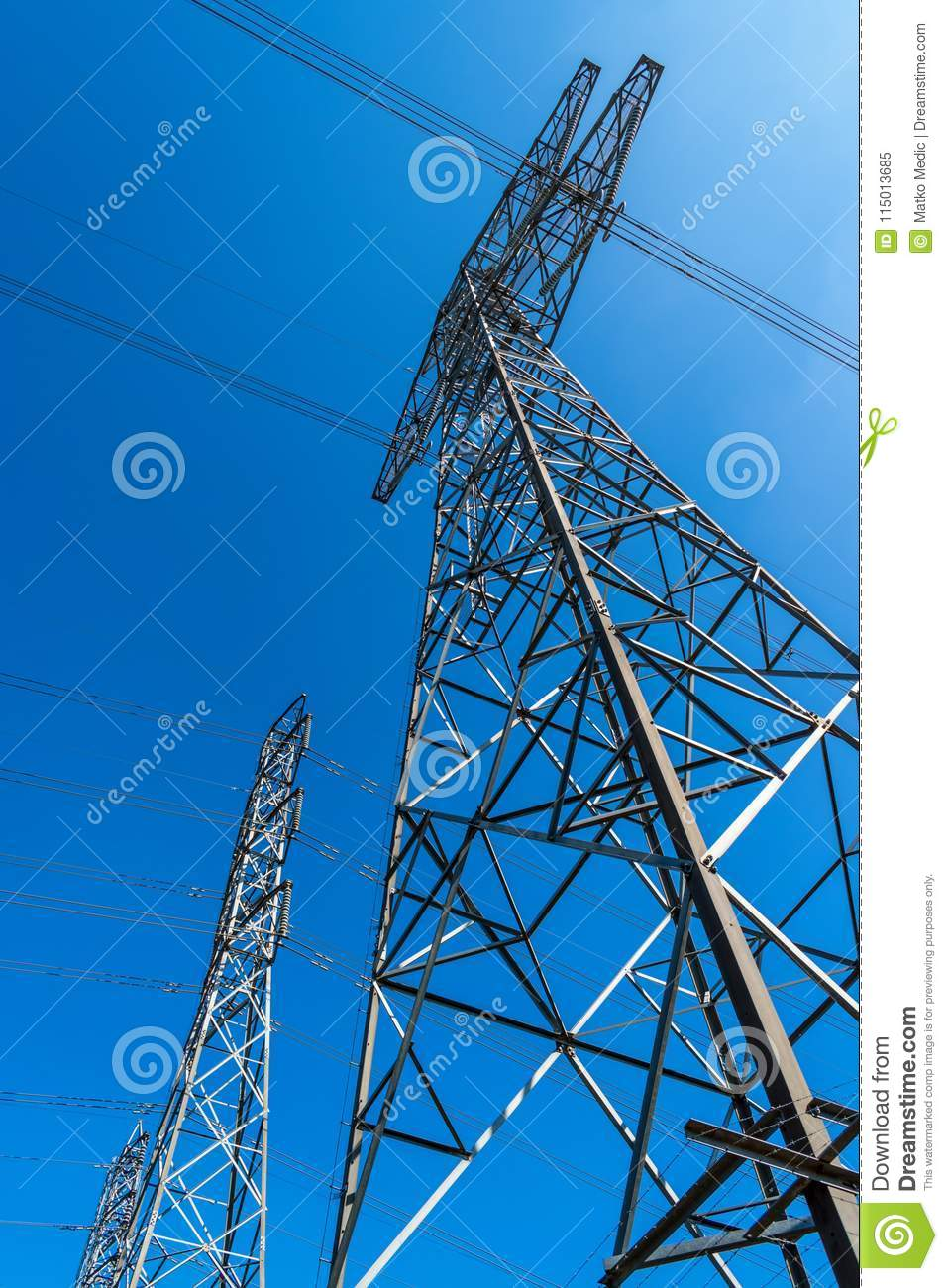 High voltage electrical power lines and clear blue sky