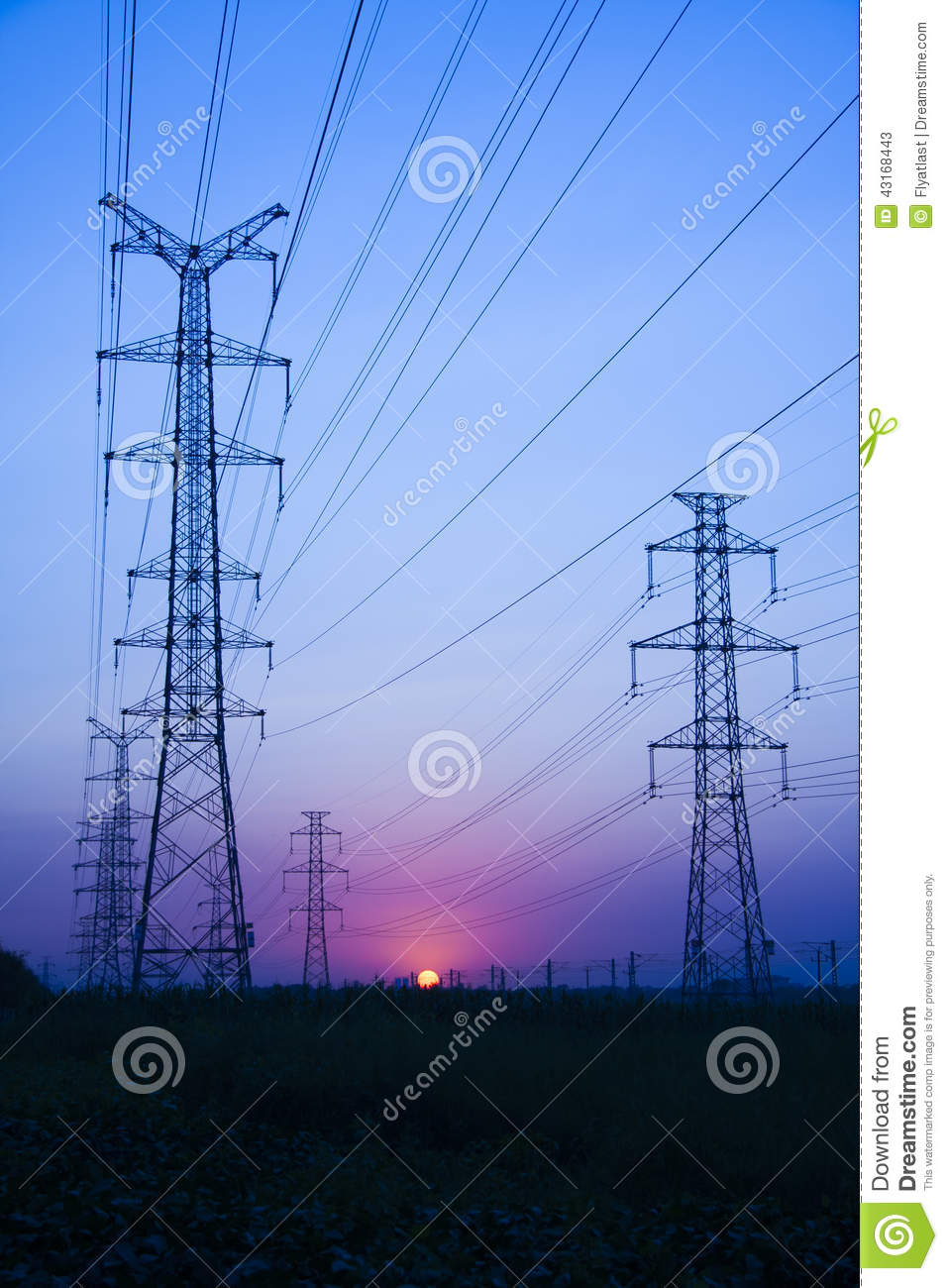 Electric Power Transmission : High voltage electricity transmission tower at sunset