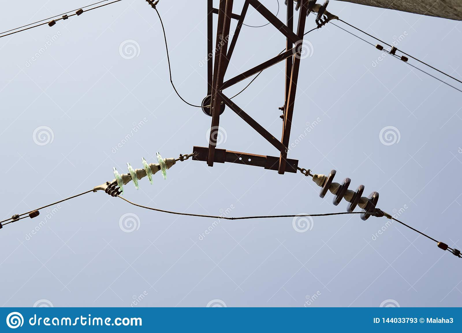 High-voltage line against the blue sky