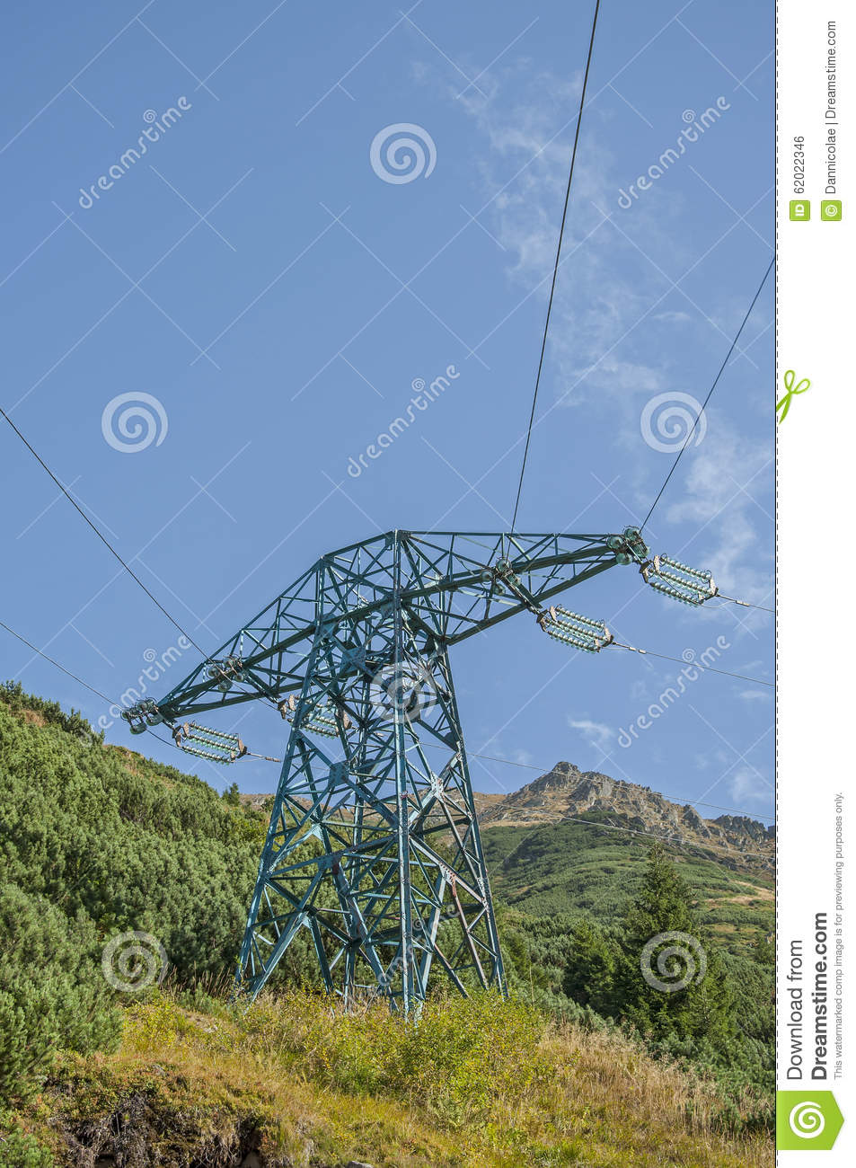 High Voltage Power Line Crossing The Mountains Stock Photo - Image ...
