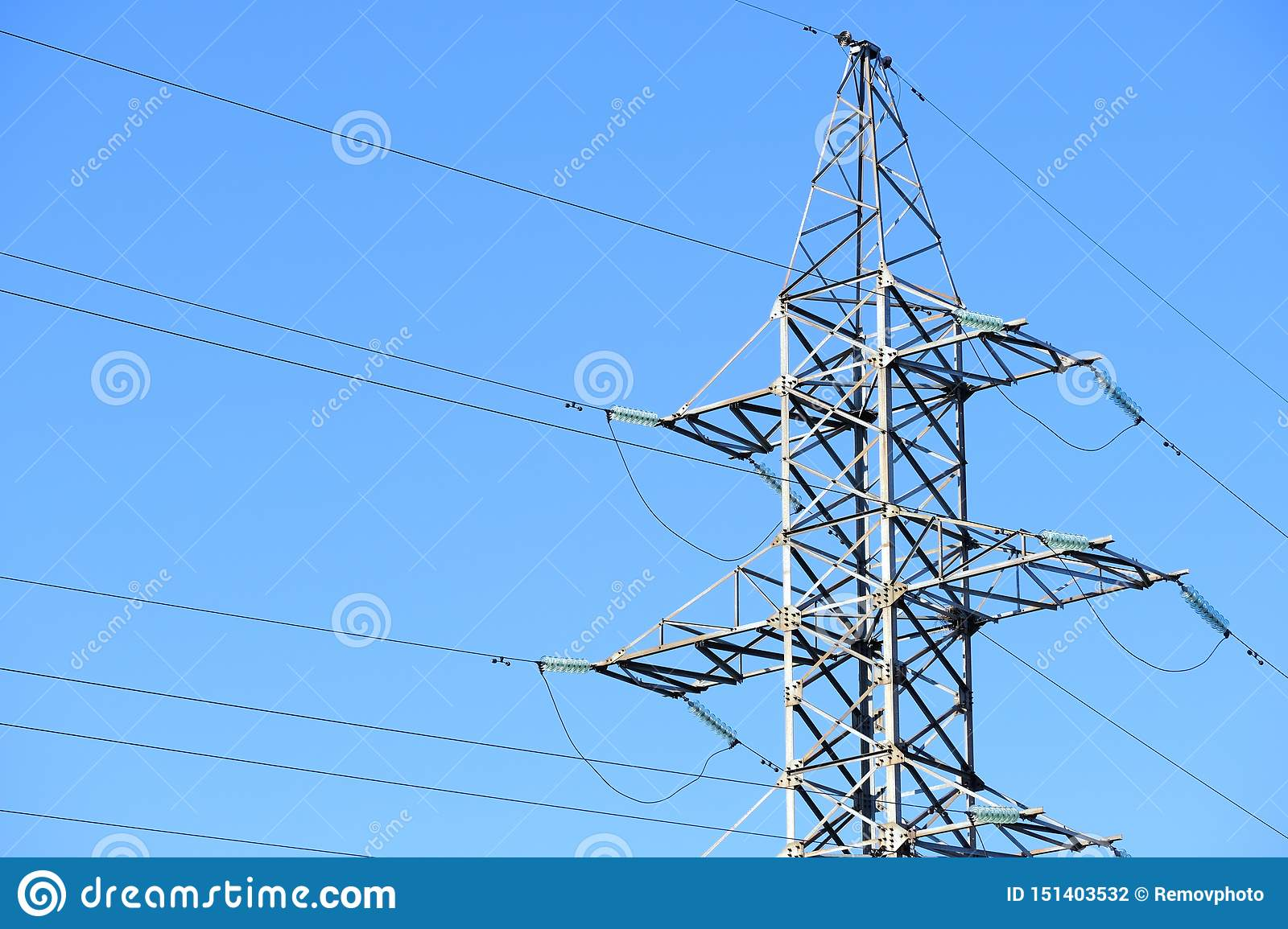 High voltage power line or tower power lines against a blue sky