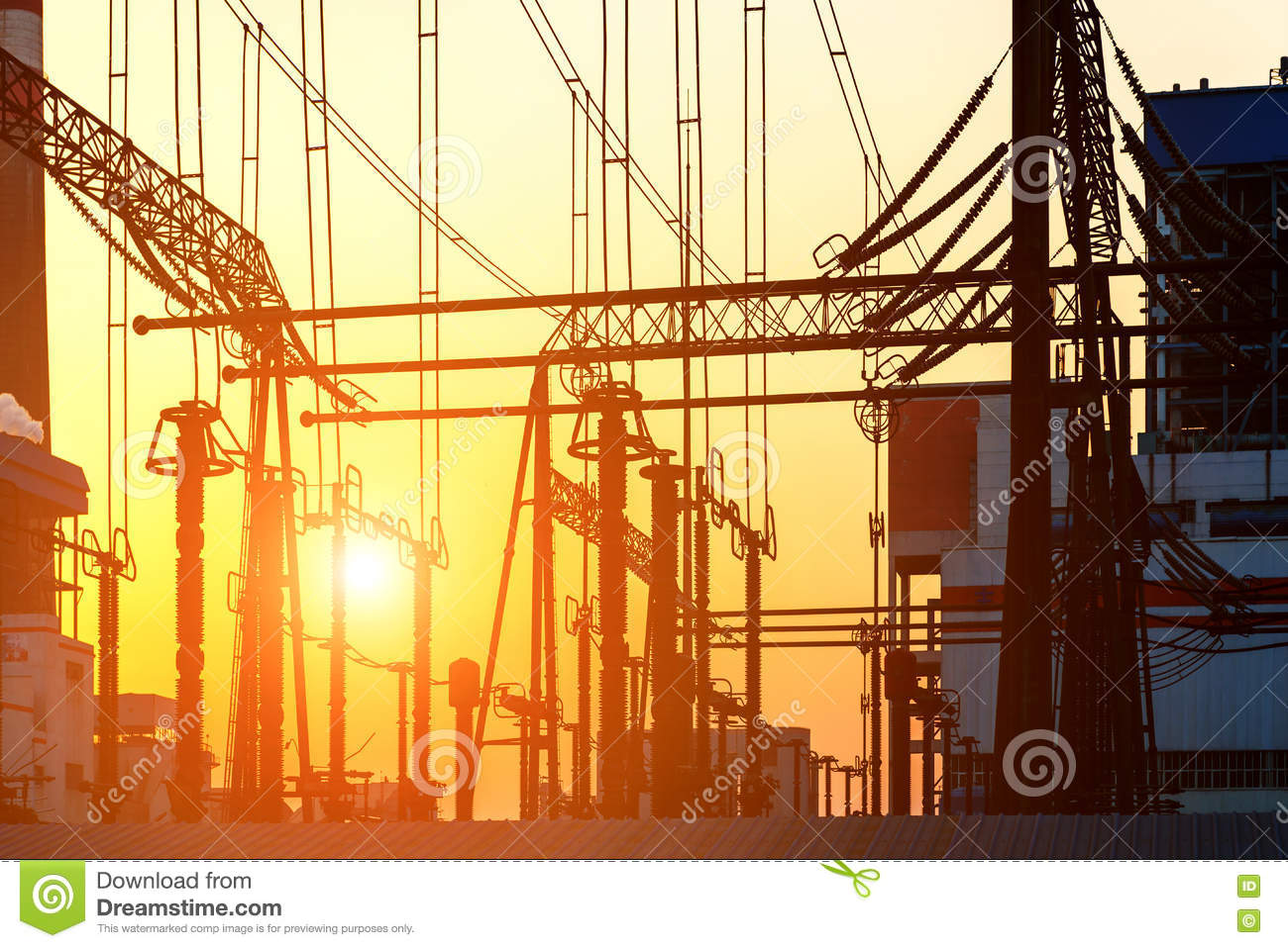 The high voltage transmission tower in the sunset