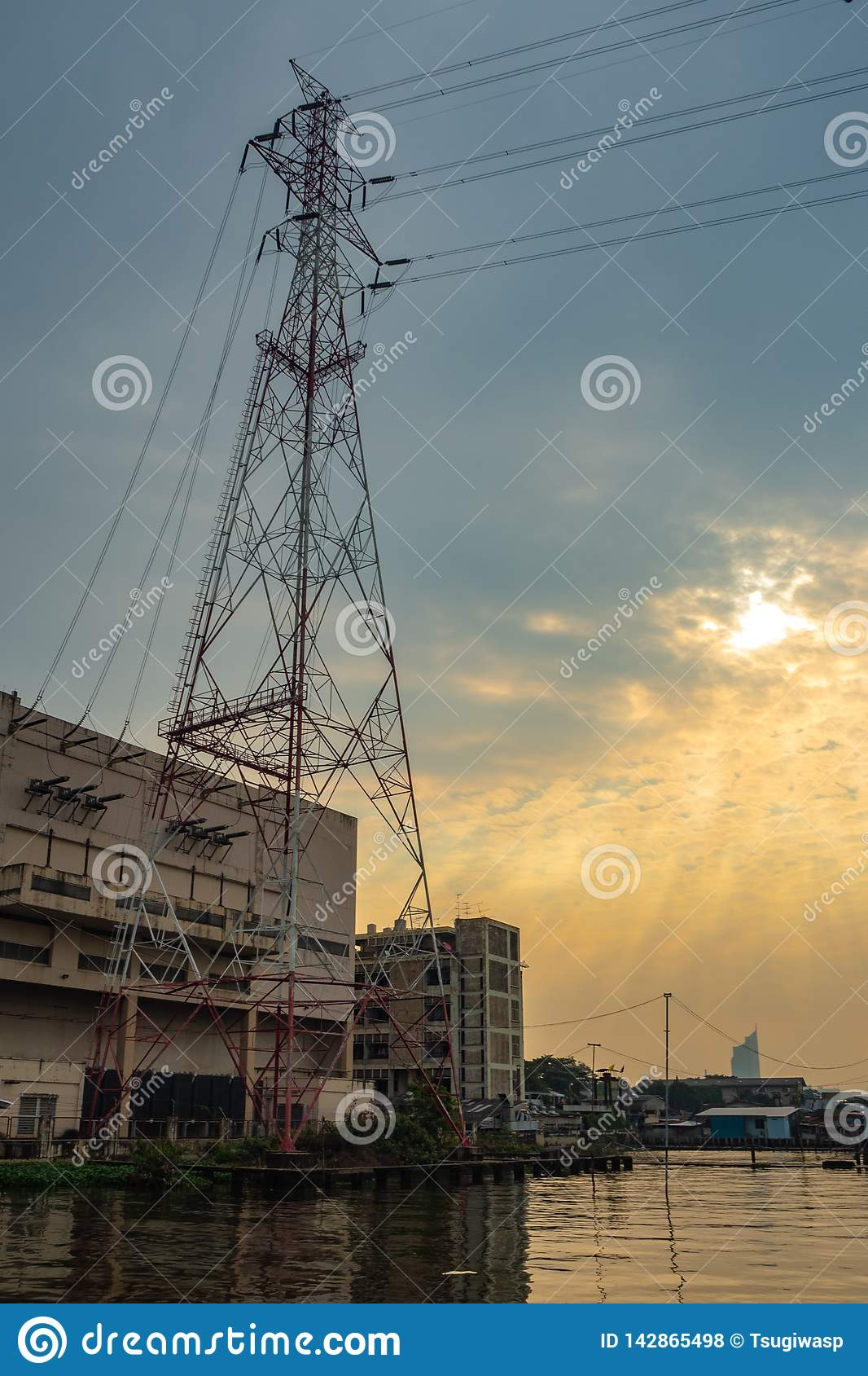 High voltage transmission towers with the cloudy sunrise sky
