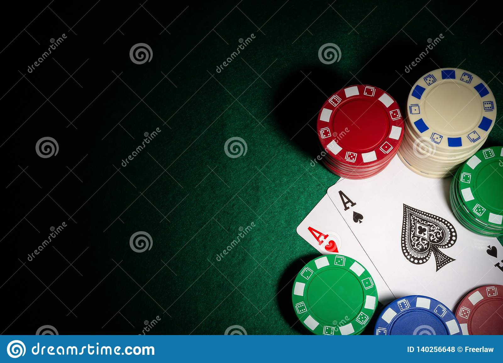 Highlighted two Ace of pokers between gambling chips on casino table