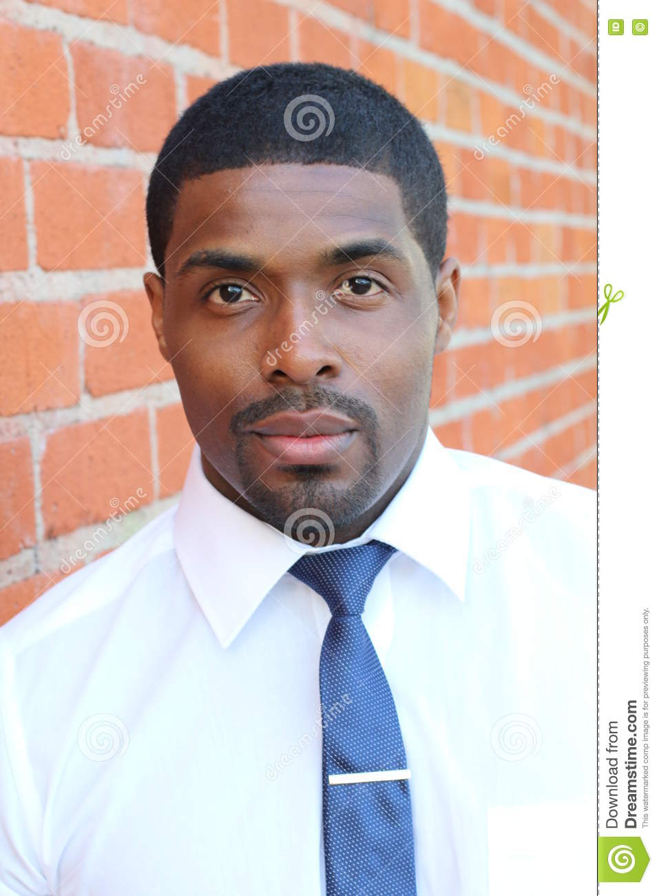 Highly detailed close-up portrait of a young smart successful African business man