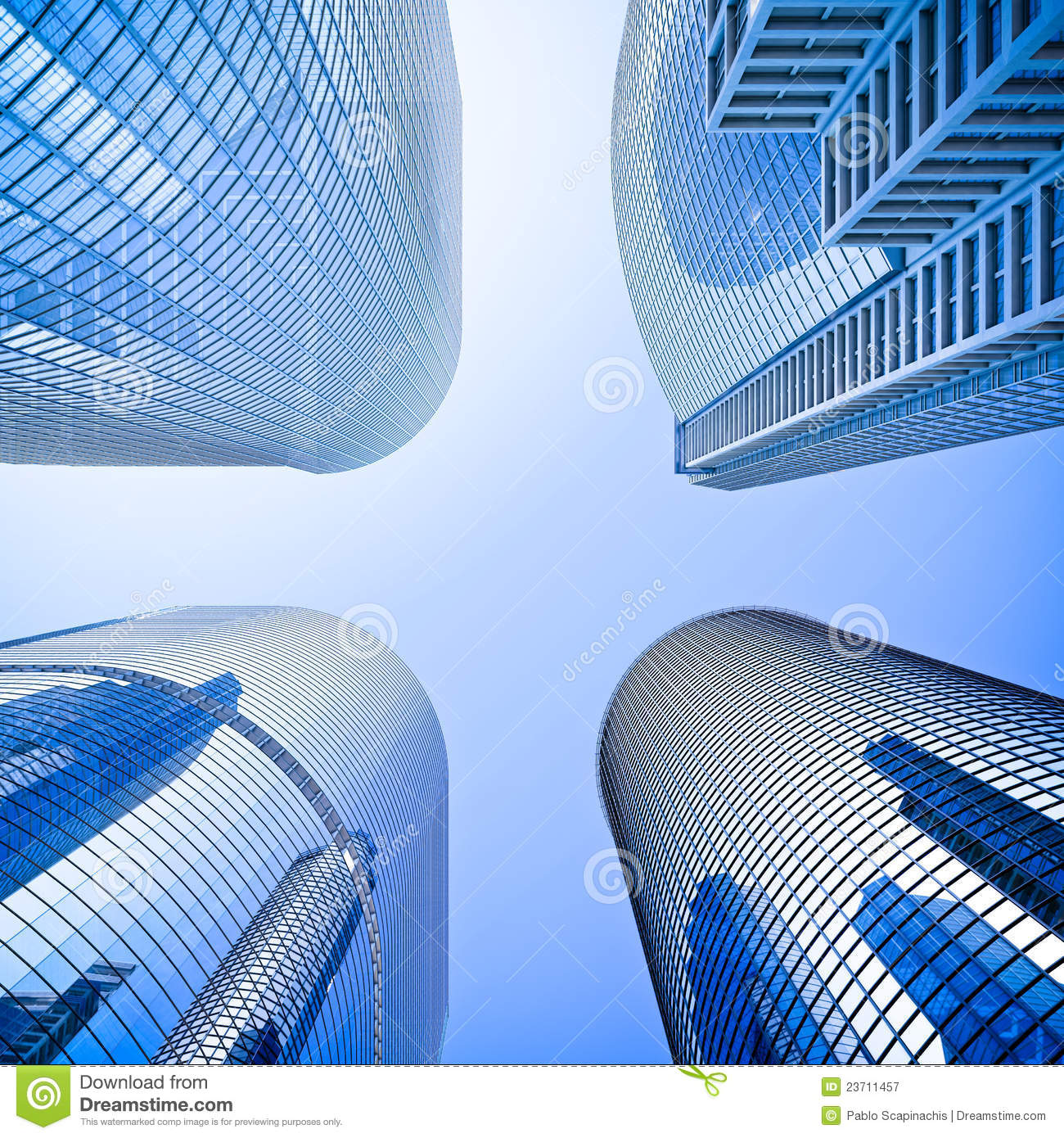 Blue Highrise Glass Skyscraper Intersection Low Angle Shot: Highrise Intersection Low Angle Shot Royalty Free Stock