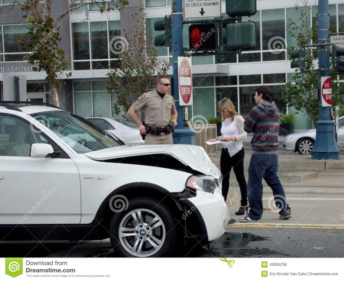 highway patrol police office assist people after their white bmw