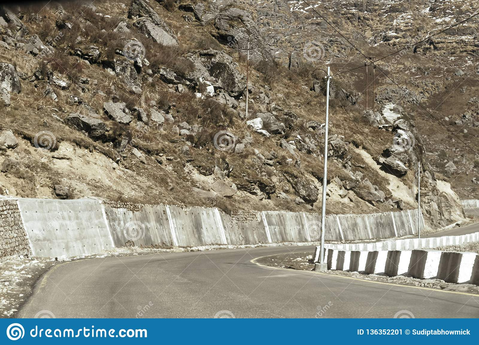 Highway road view of India China border near Nathu La mountain pass in Himalayas which connects Indian state Sikkim with China`s