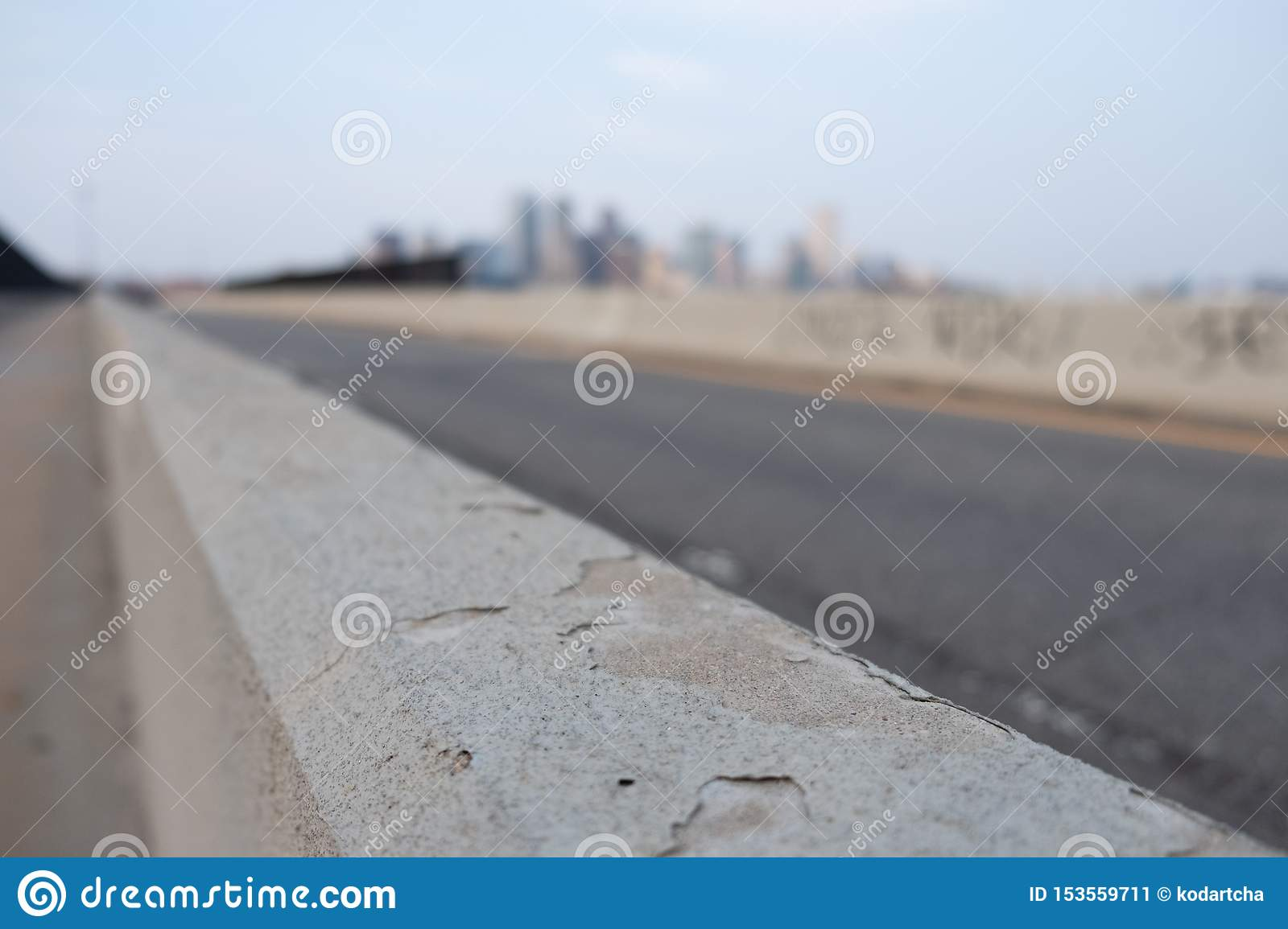 Highway side wall with blurred city in the background