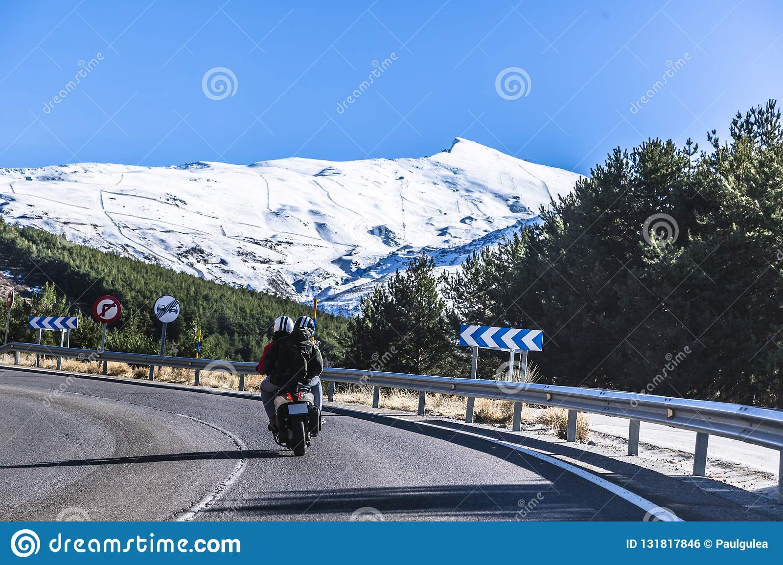 Highway in Spain to mountains Sierra Nevada with scooter and passengers