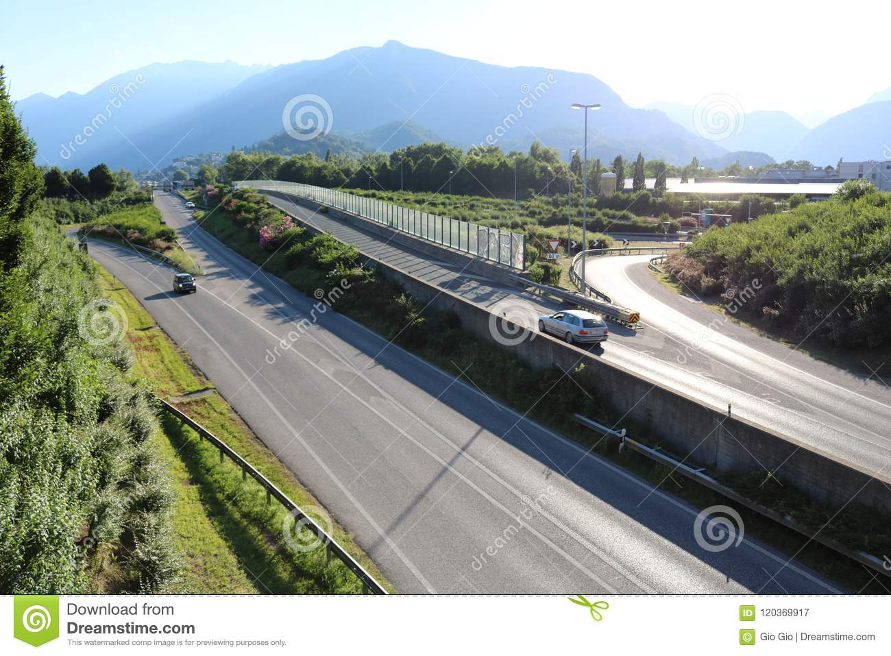 Highway in switzerland with mountain in background