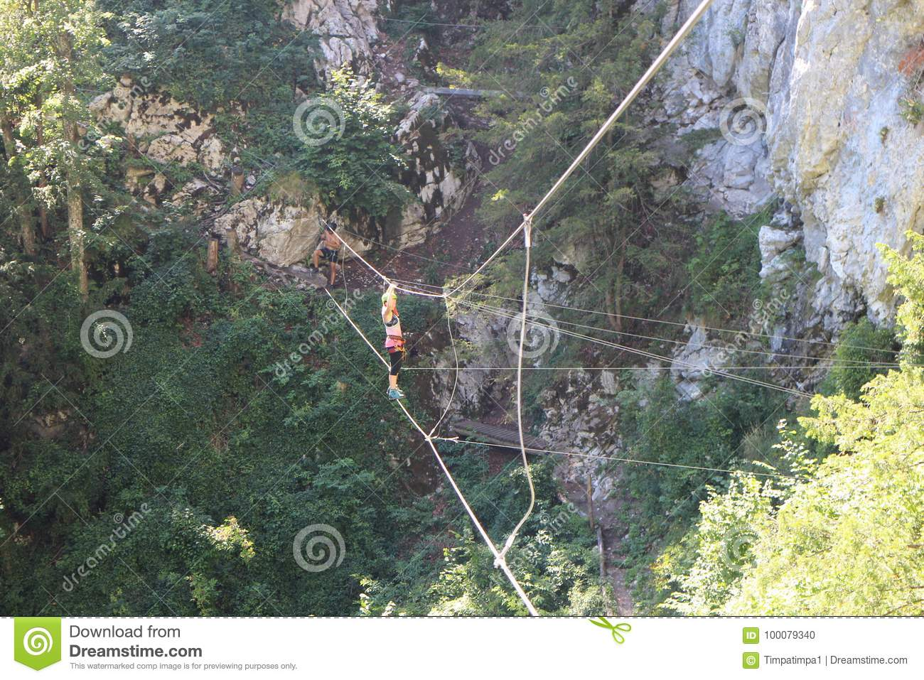 Klettersteig Clipart : Hiker on cable bridge in via ferrata trattenbacher klettersteig
