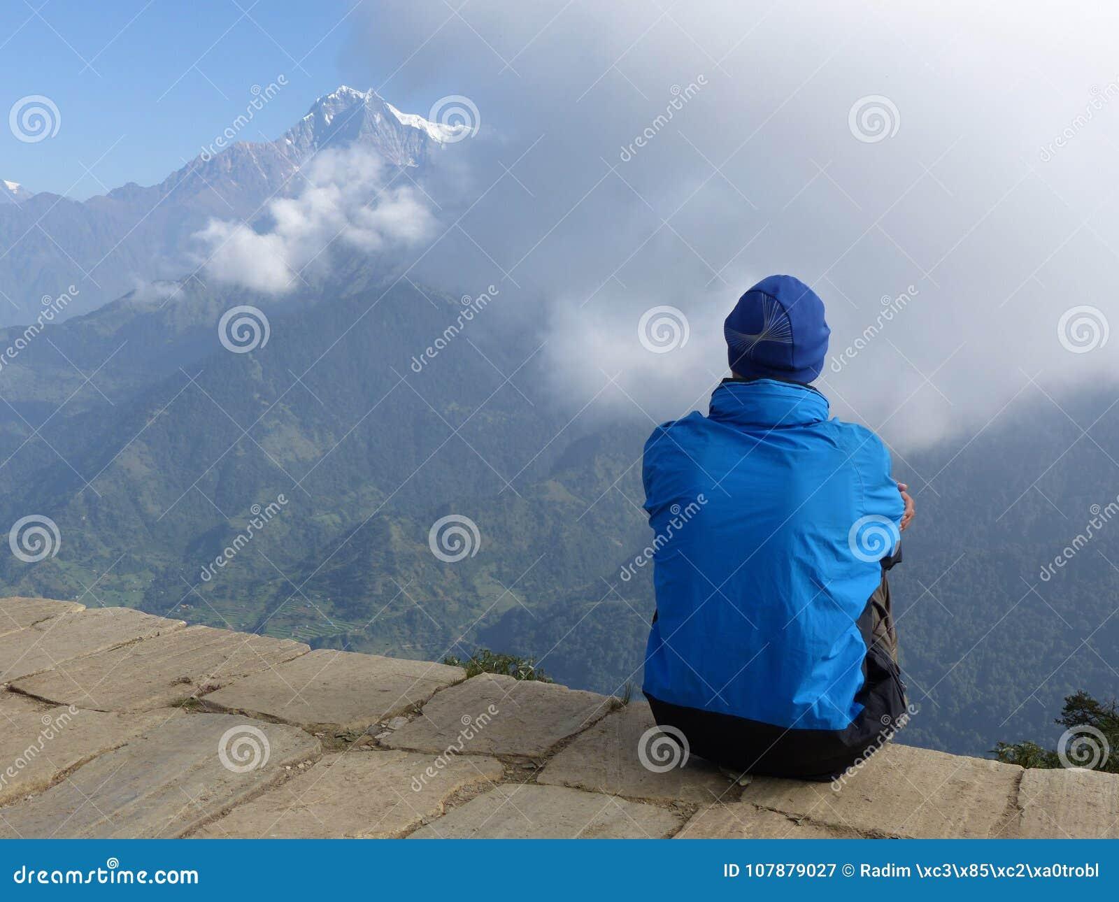 Hiker looking to the mountain on Poon Hill, Dhaulagiri range, Ne