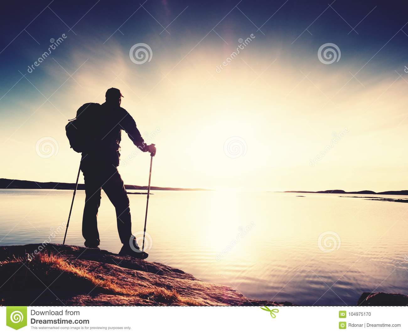Hiker Man In Dark Sportswear And With Sporty Backpack On Rocky Coast Blue Sky With Clouds Magic Day Stock Photo Image Of Looking Freedom 104975170