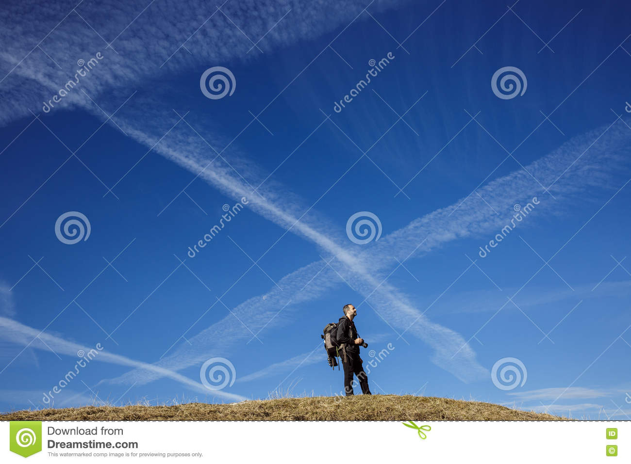 Hiker photographer on a mountain top