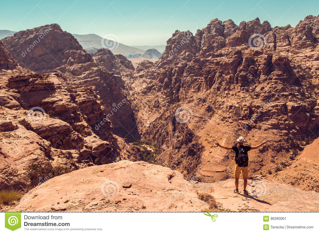 Hiker with raised hand impressed amazing view. Meditation nature. Achievement concept. Ecotourism. Copy space. Rocky mountain land