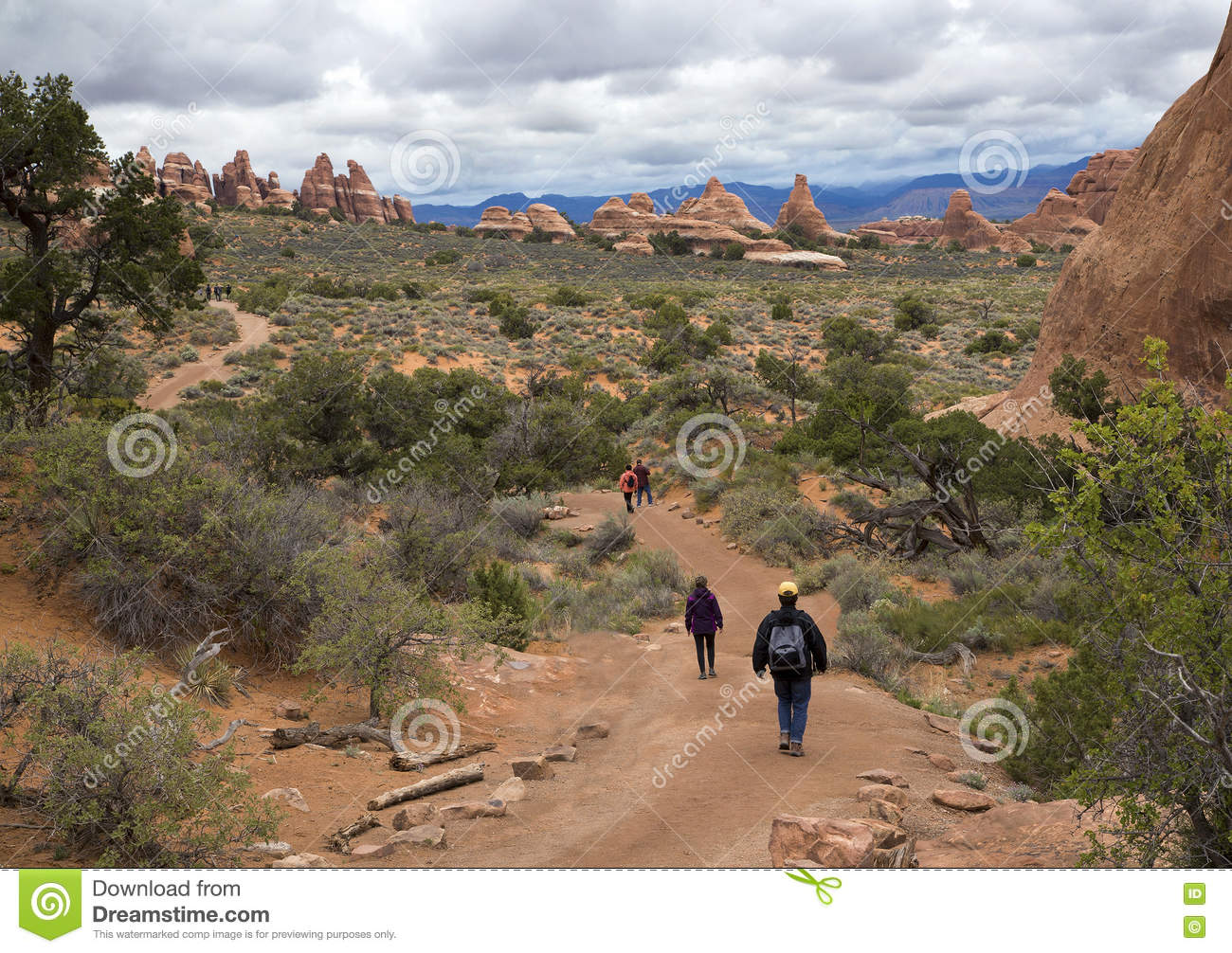 Hiker Walking Down A Trail At The Devils Garden At Arches National ...