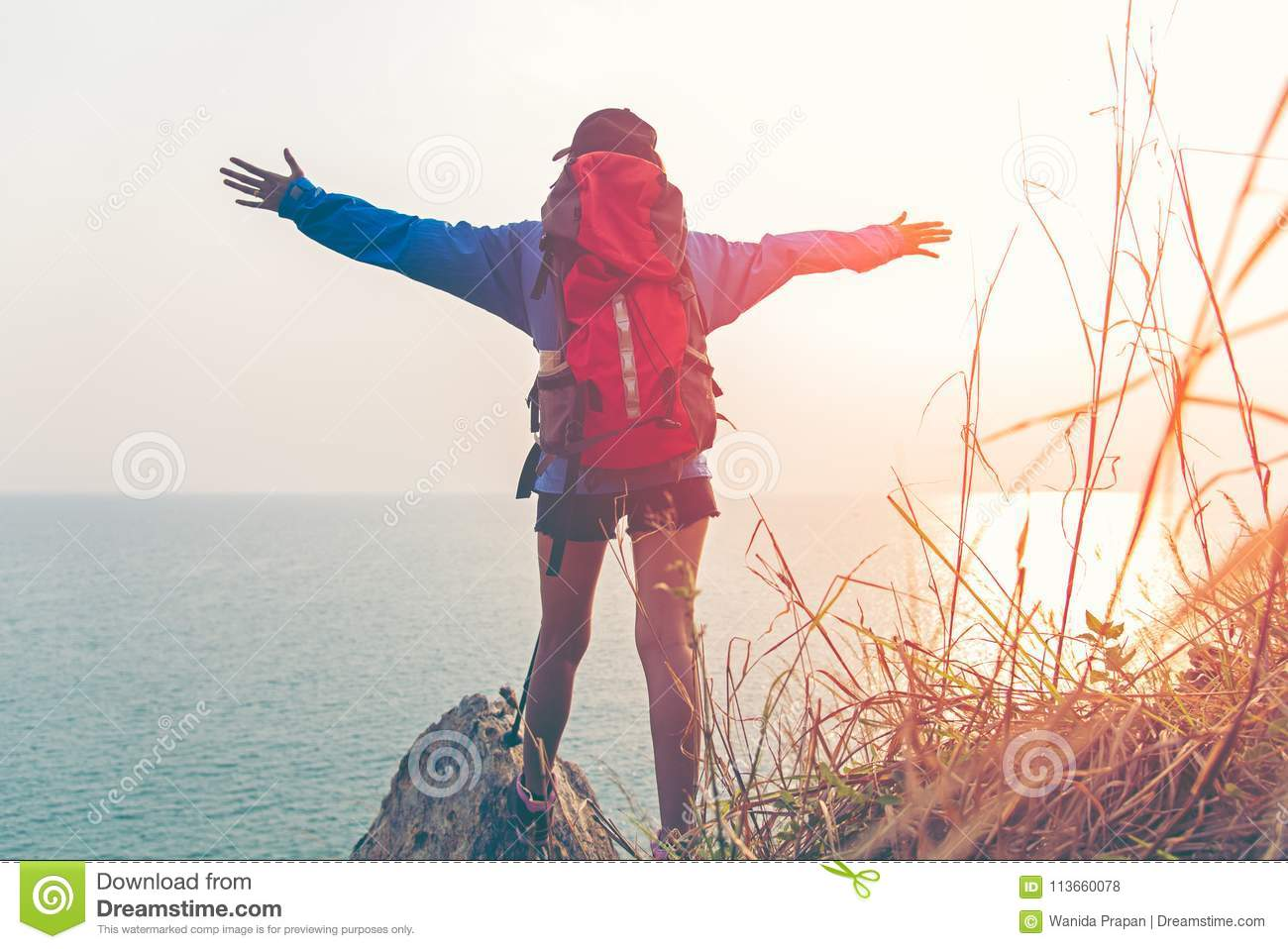 Hiker woman happy feeling freedom good and strong weight victorious facing on the natural mountain,