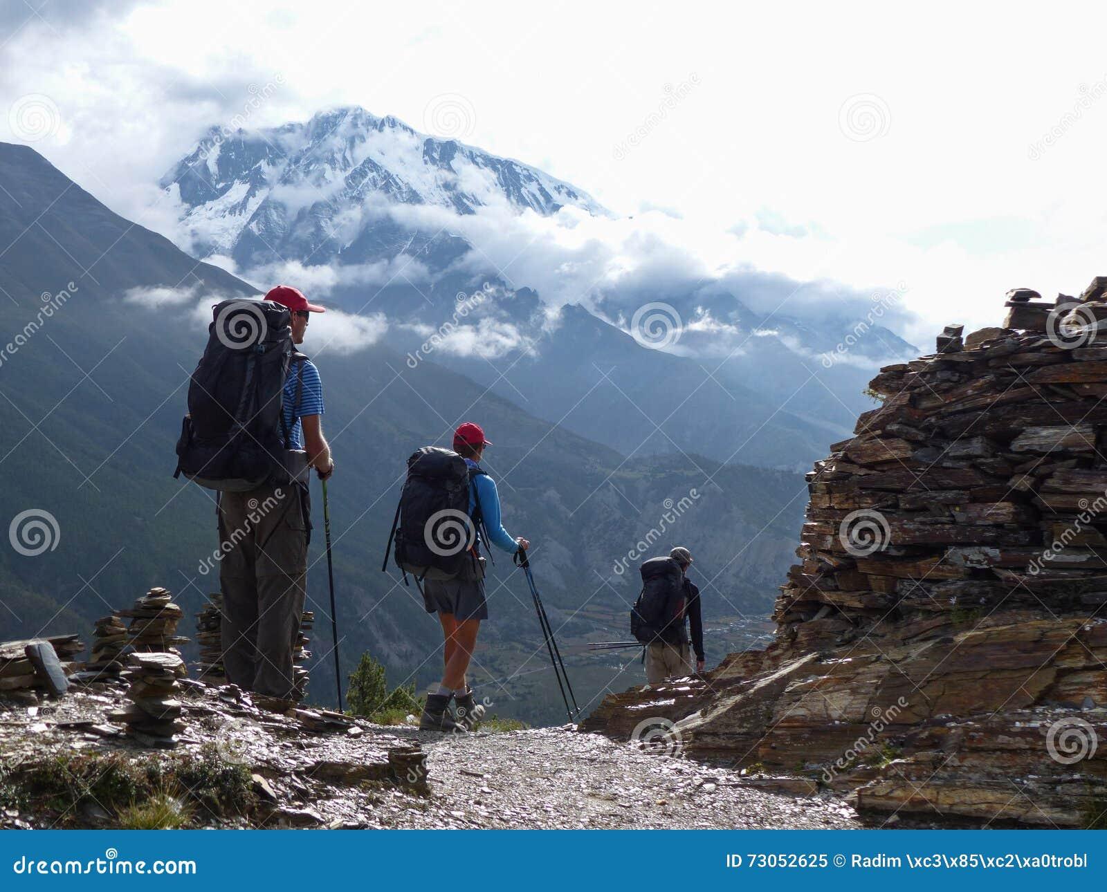 Hikers in autumnal Himalaya, view to Annapurna III