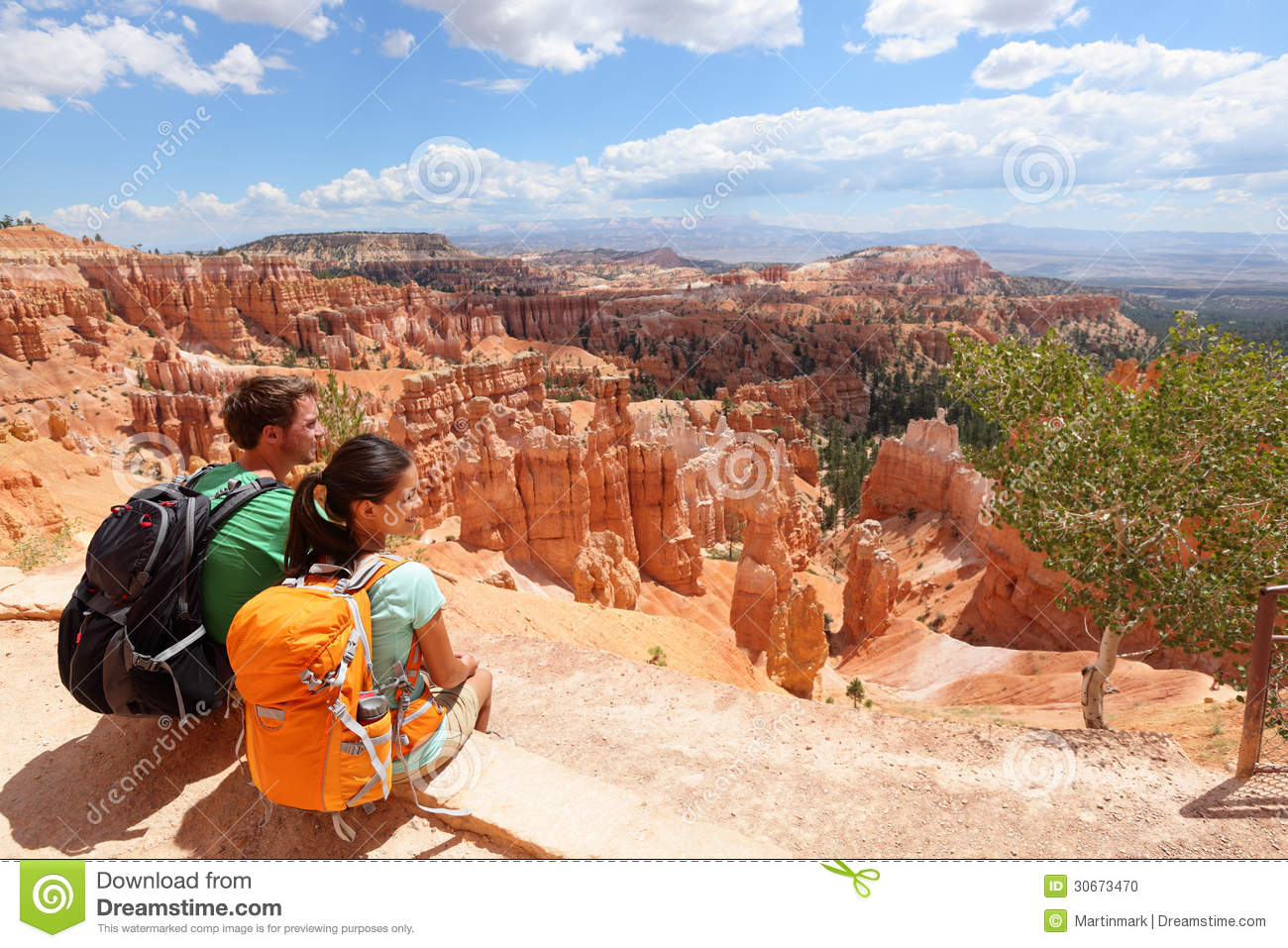 Hikers In Bryce Canyon Resting Enjoying View Stock Photo