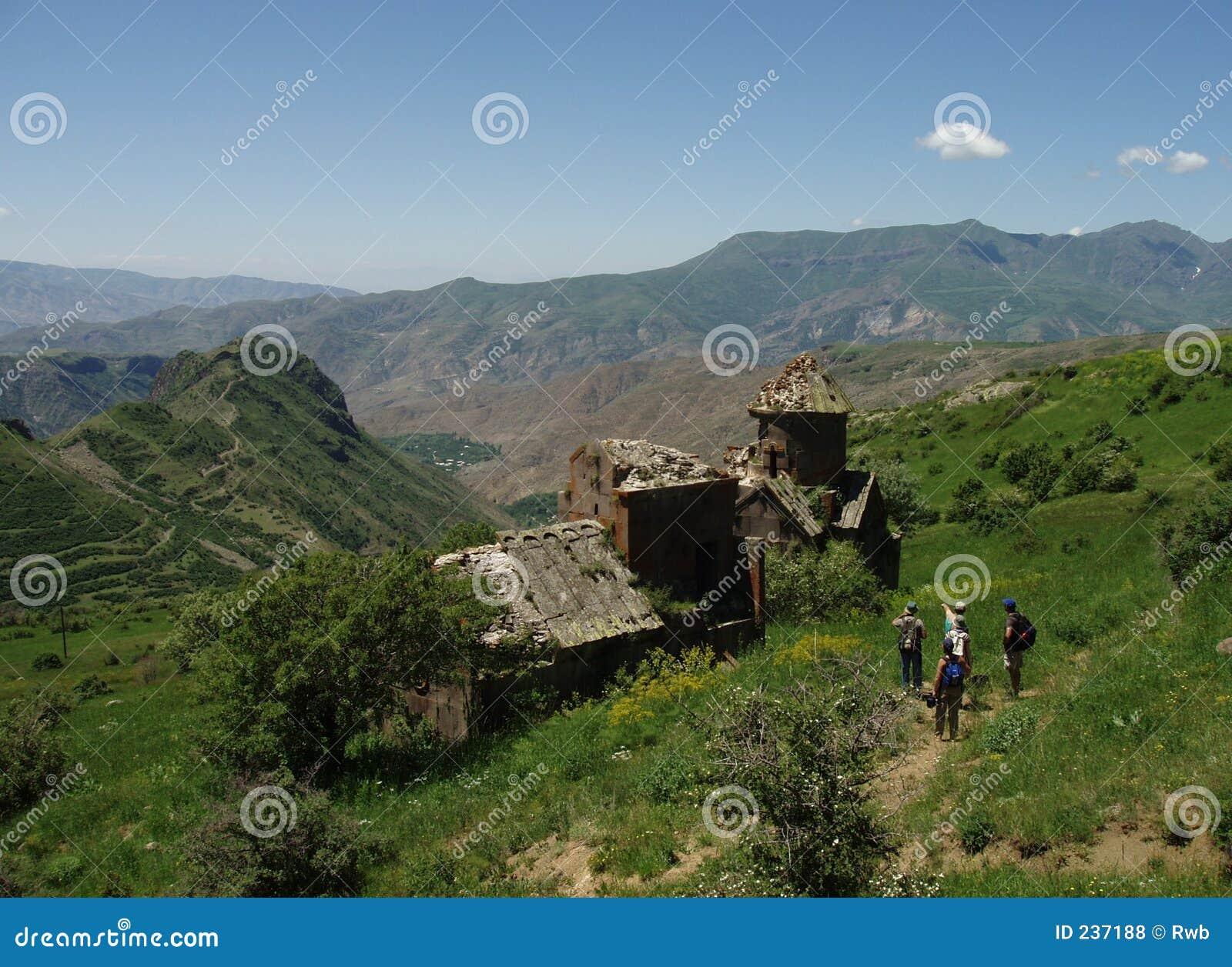 Hikers at Medieval Church Ruins