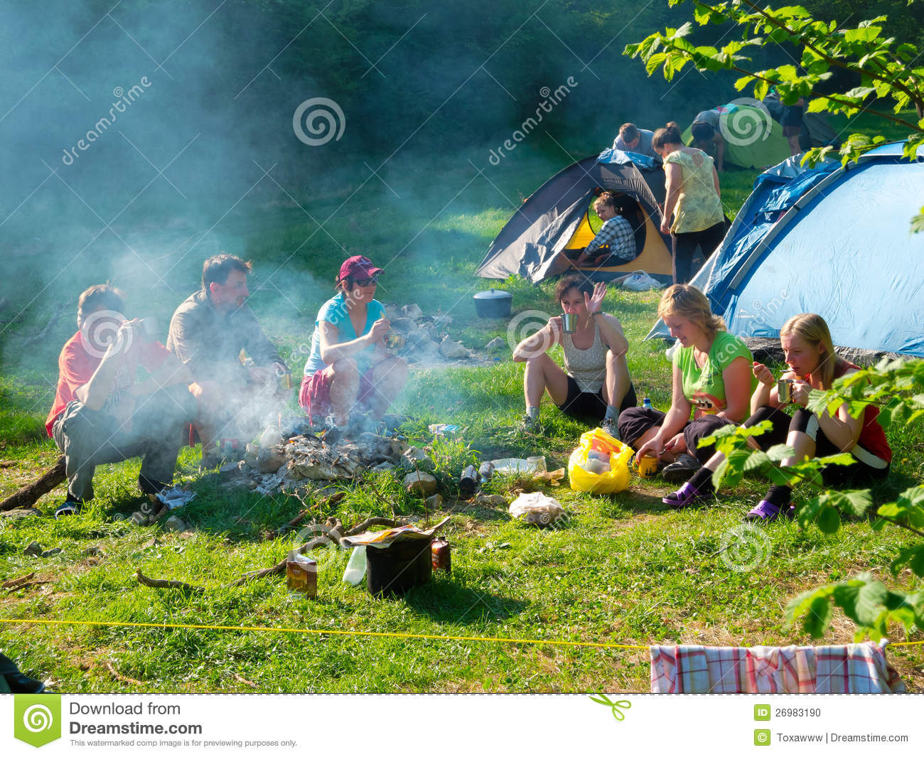 Hikers rest in a tent camp