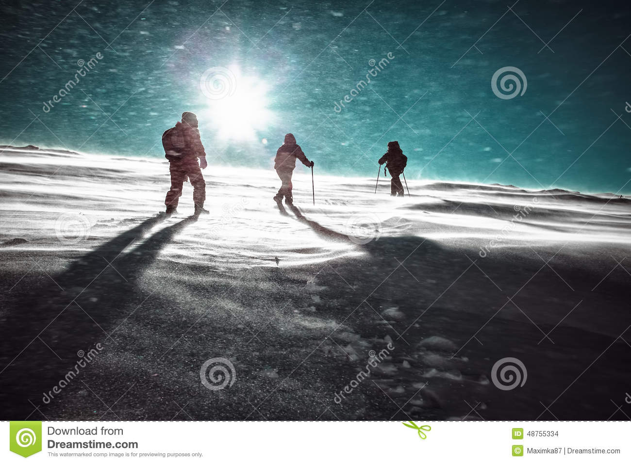 Hikers and snowfall in winter mountains