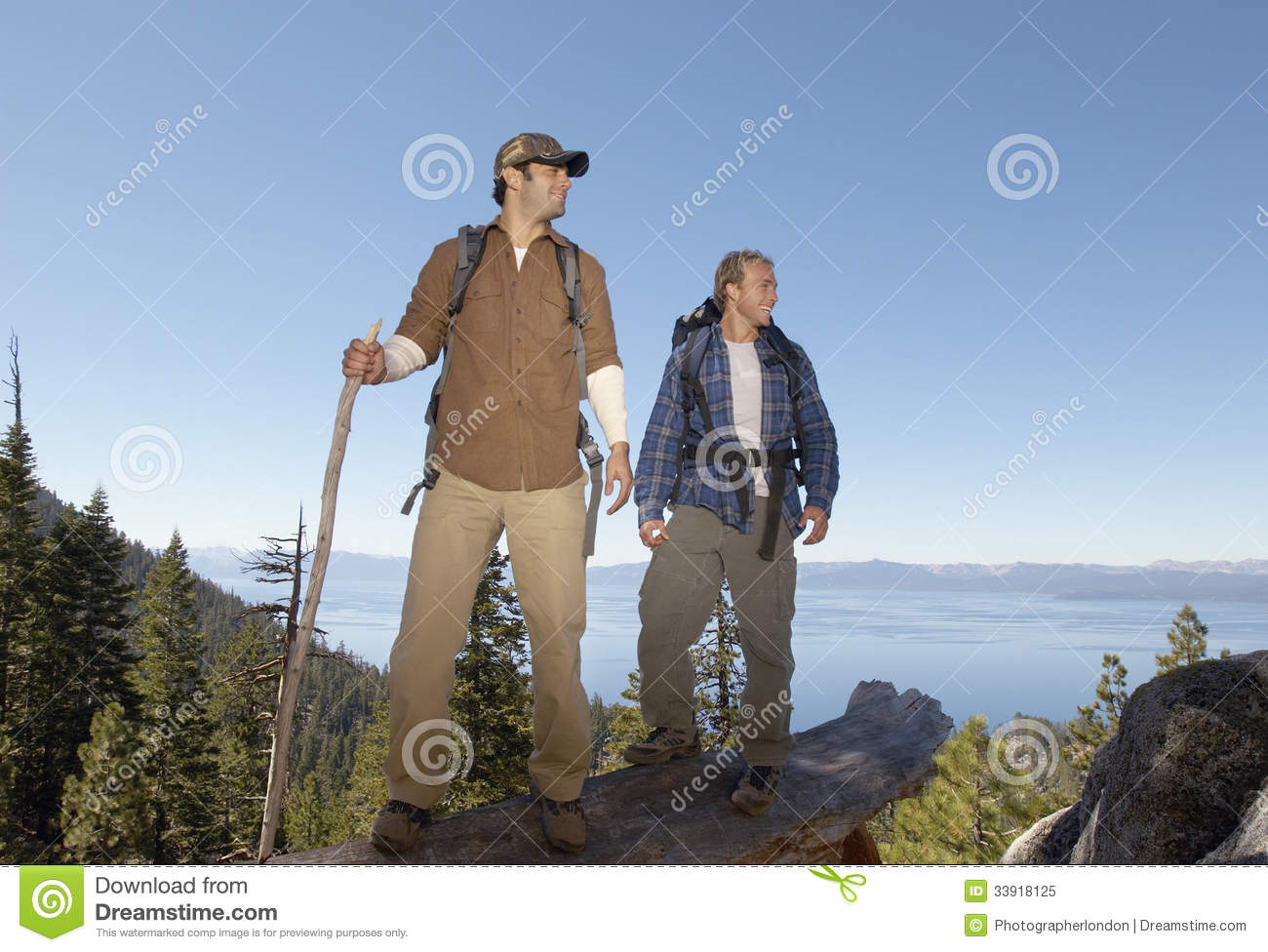 Hikers Standing On Log Near Forest Stock Image - Image of