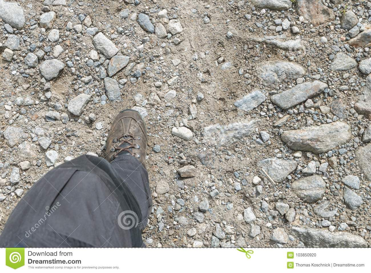 Hiking boots on a stony hiking trail