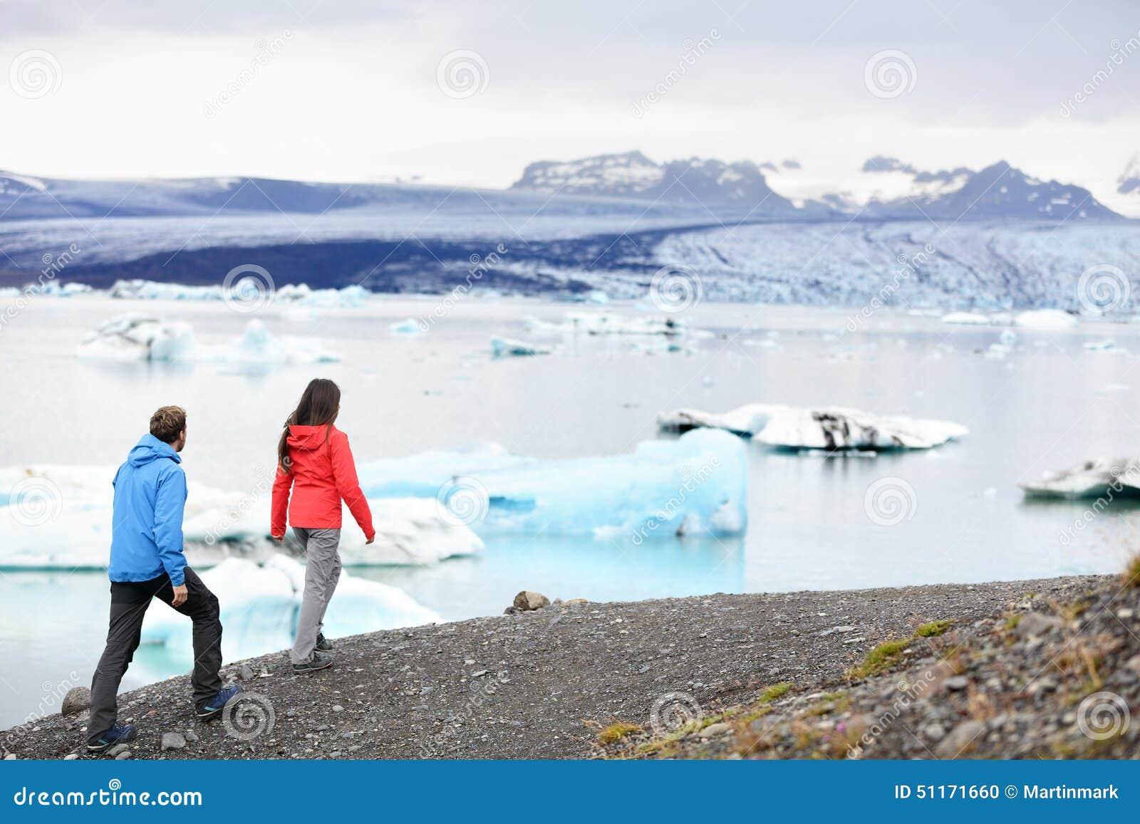 Hiking couple on Iceland Jokulsarlon glacier lake