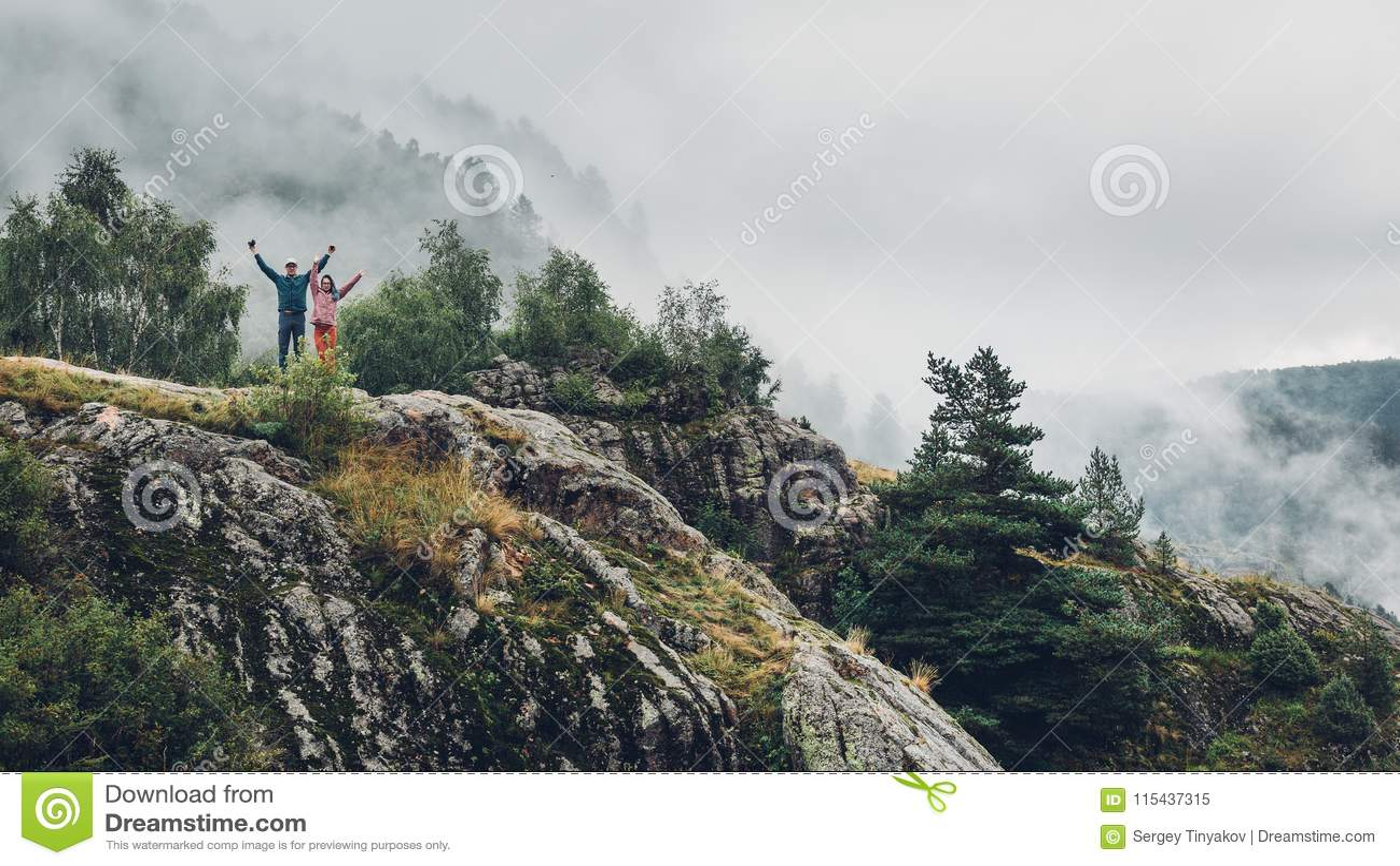 Traveler couple in love enjoying view of mountains