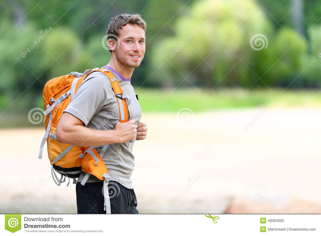 Hiking Man Portrait With Backpack In Nature Stock Photo