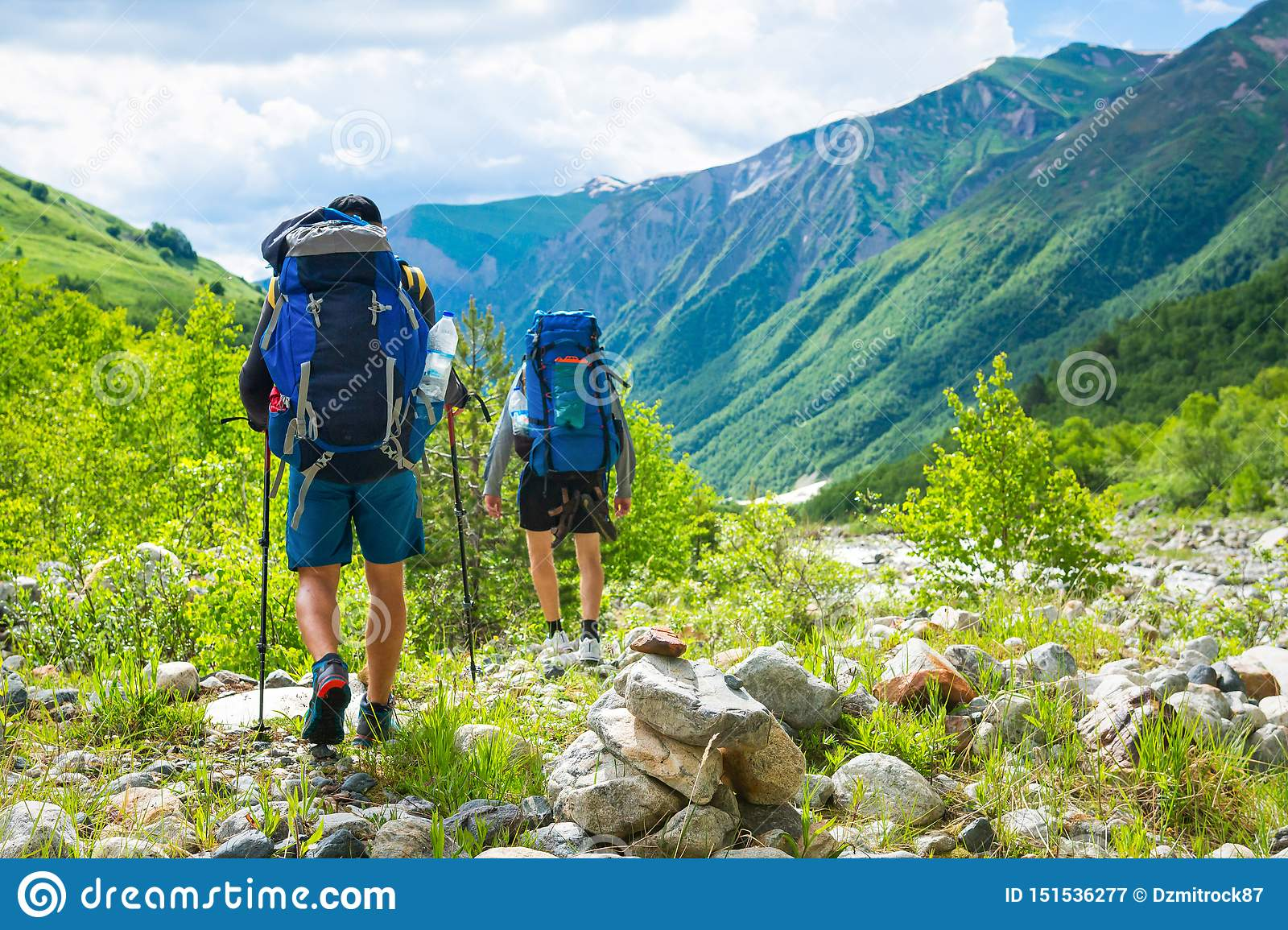 Hiking In Mountains. Men Hike In Mountain Trail. Tourists ...