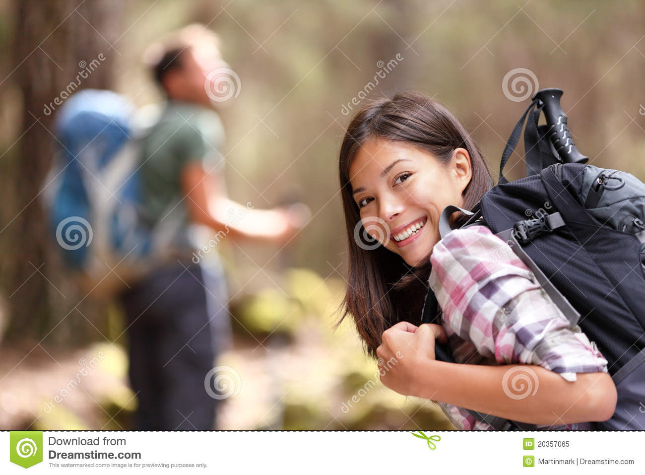 Hiking people friends - girl hiker in forest