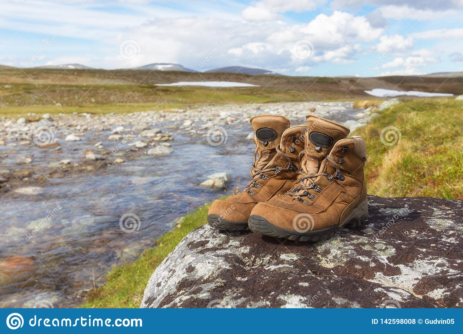 Hiking shoes of a hiker on a rock