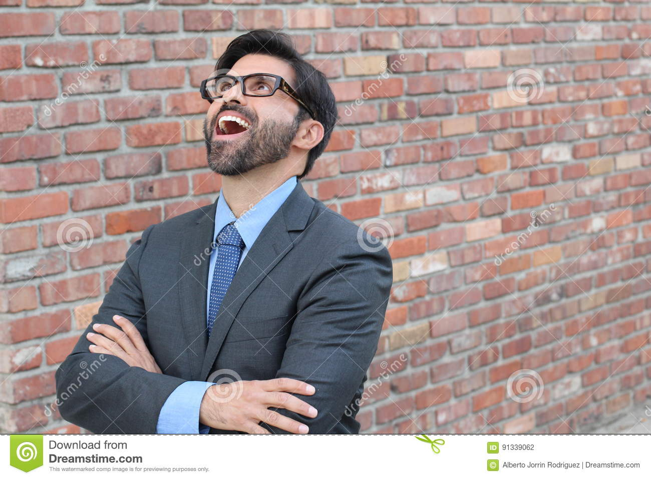 Hilarious businessman looking up with his mouth wide open