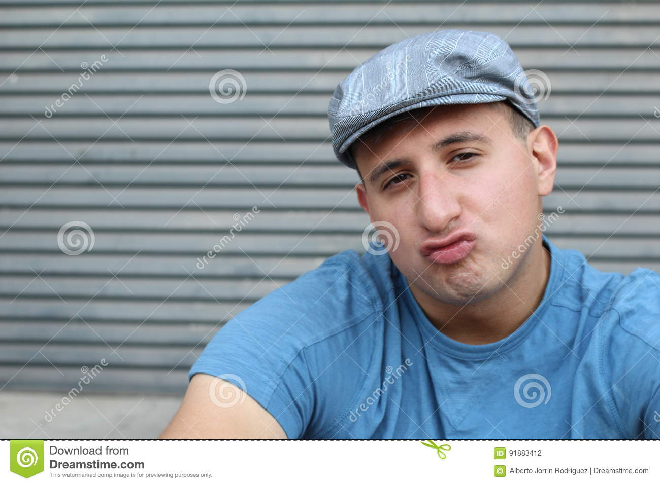 Hilarious young guy with pursed lips or duck lips expression.