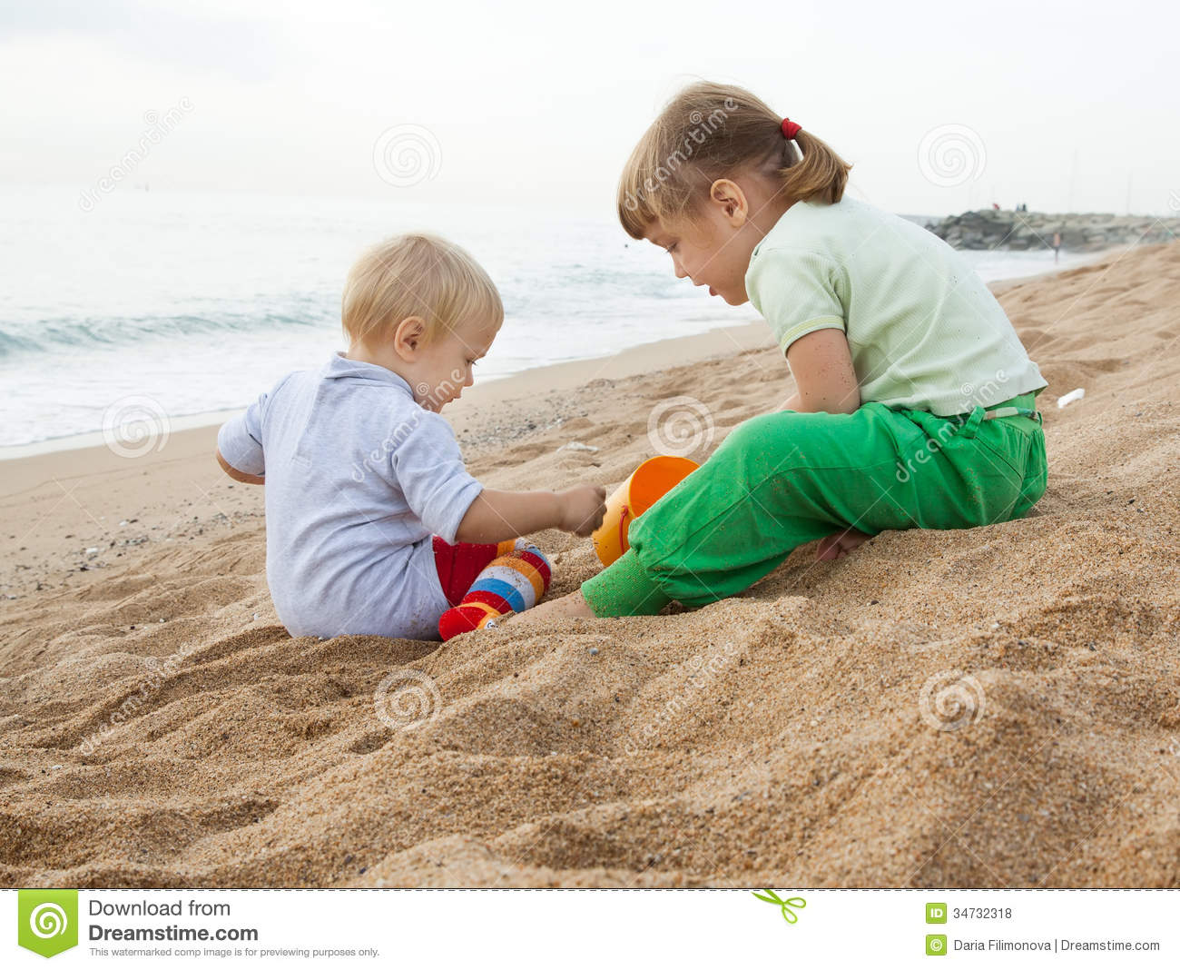 hildren playing with sand at sea stock photo image 34732318. Black Bedroom Furniture Sets. Home Design Ideas