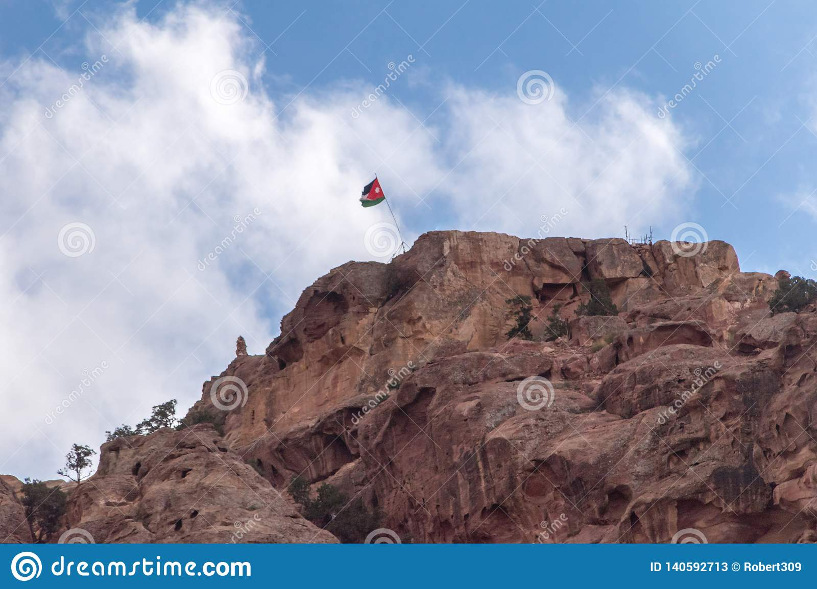 Hill with Jordanian flag in Petra.