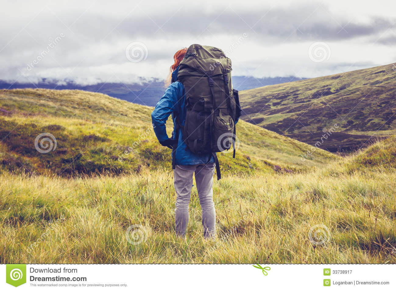 Hill walker standing in the middle of mountain wilderness