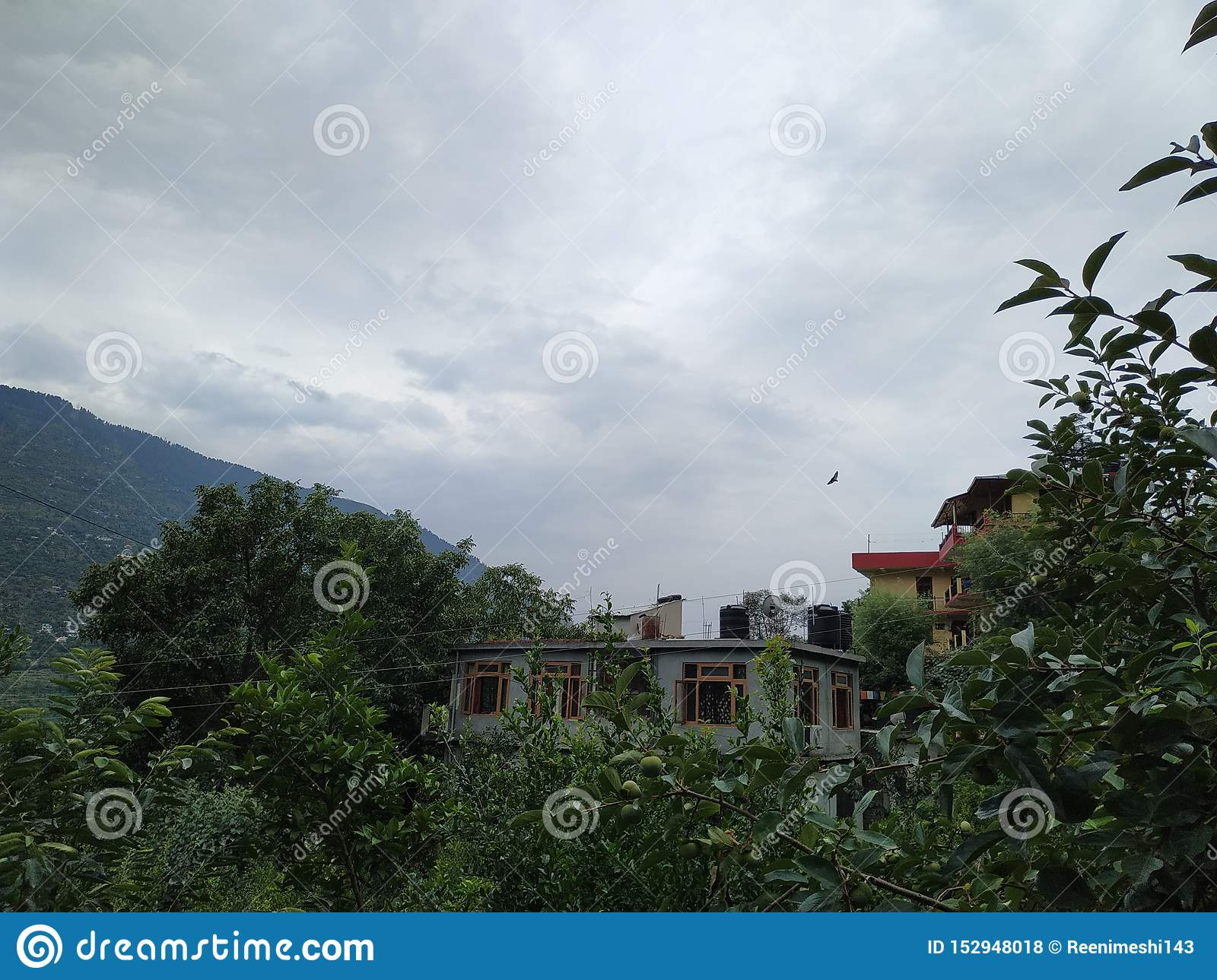 Hills, cloudy weather and beautifull small village`s houses