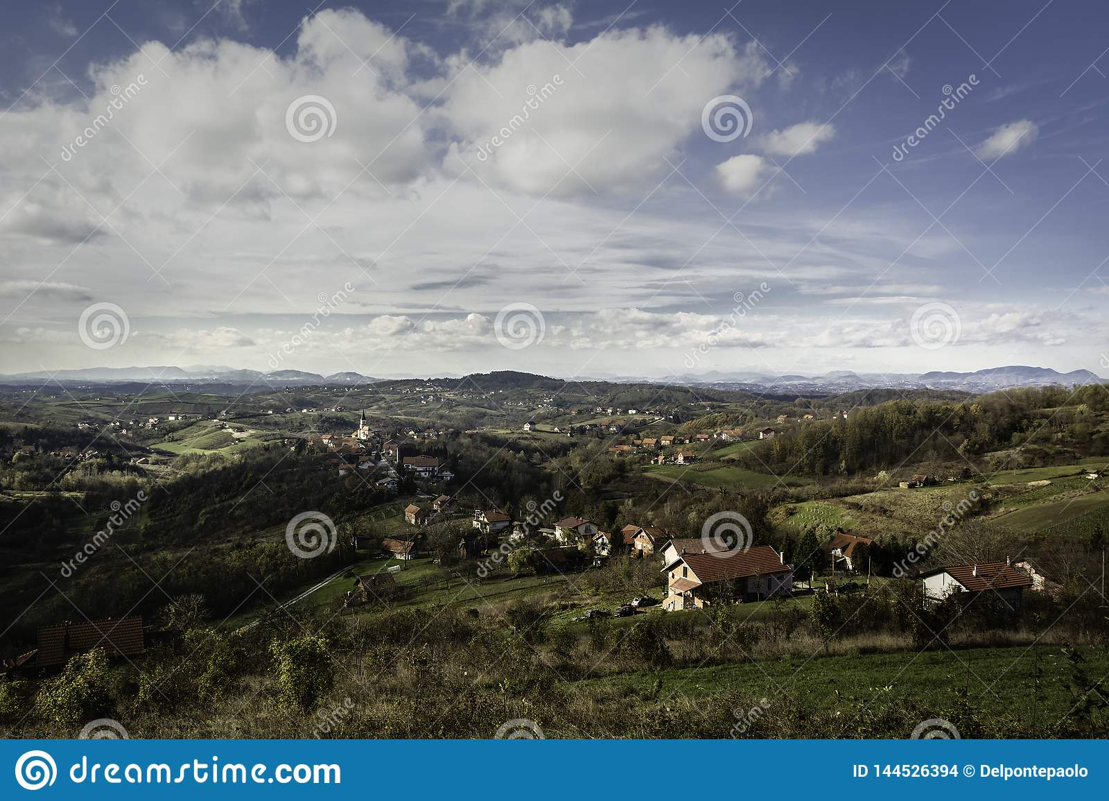 Hilly area of Zagorje in early autumn with lot of villages and mountains in distance
