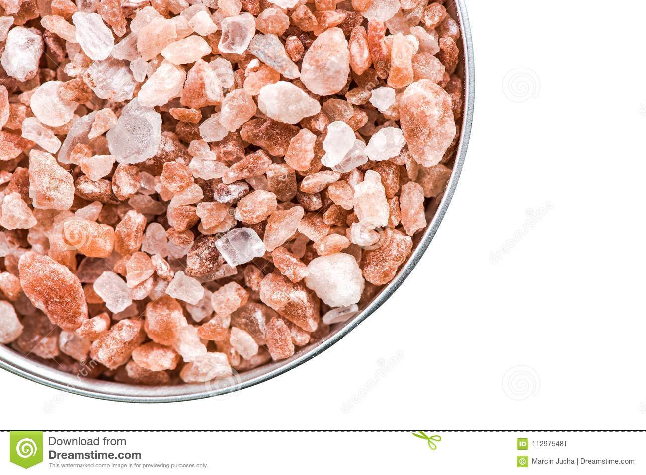 Himalayan salt cristals seeds in pot isolated on white