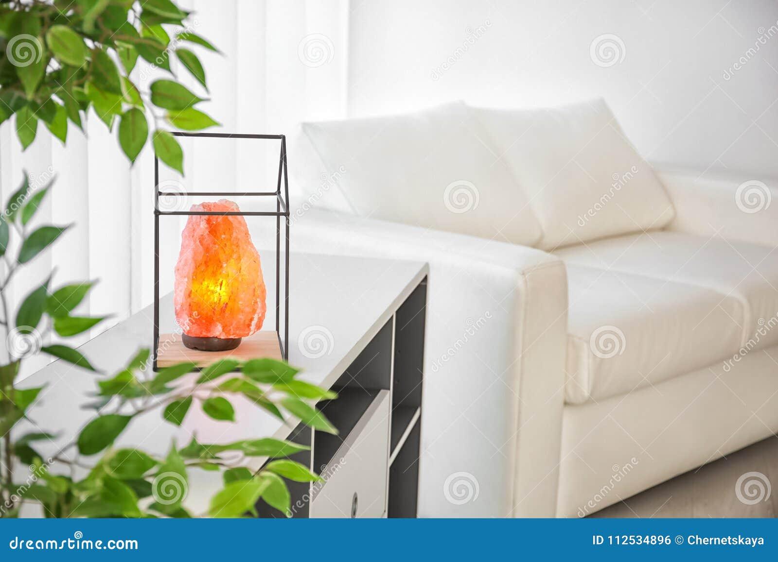 Himalayan salt lamp on shelving unit